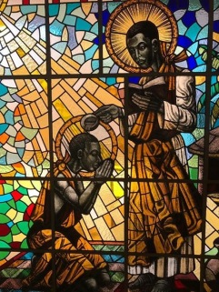 St._Kizito_being_baptised_by_St._Charles_Lwanga_at_Munyonyo